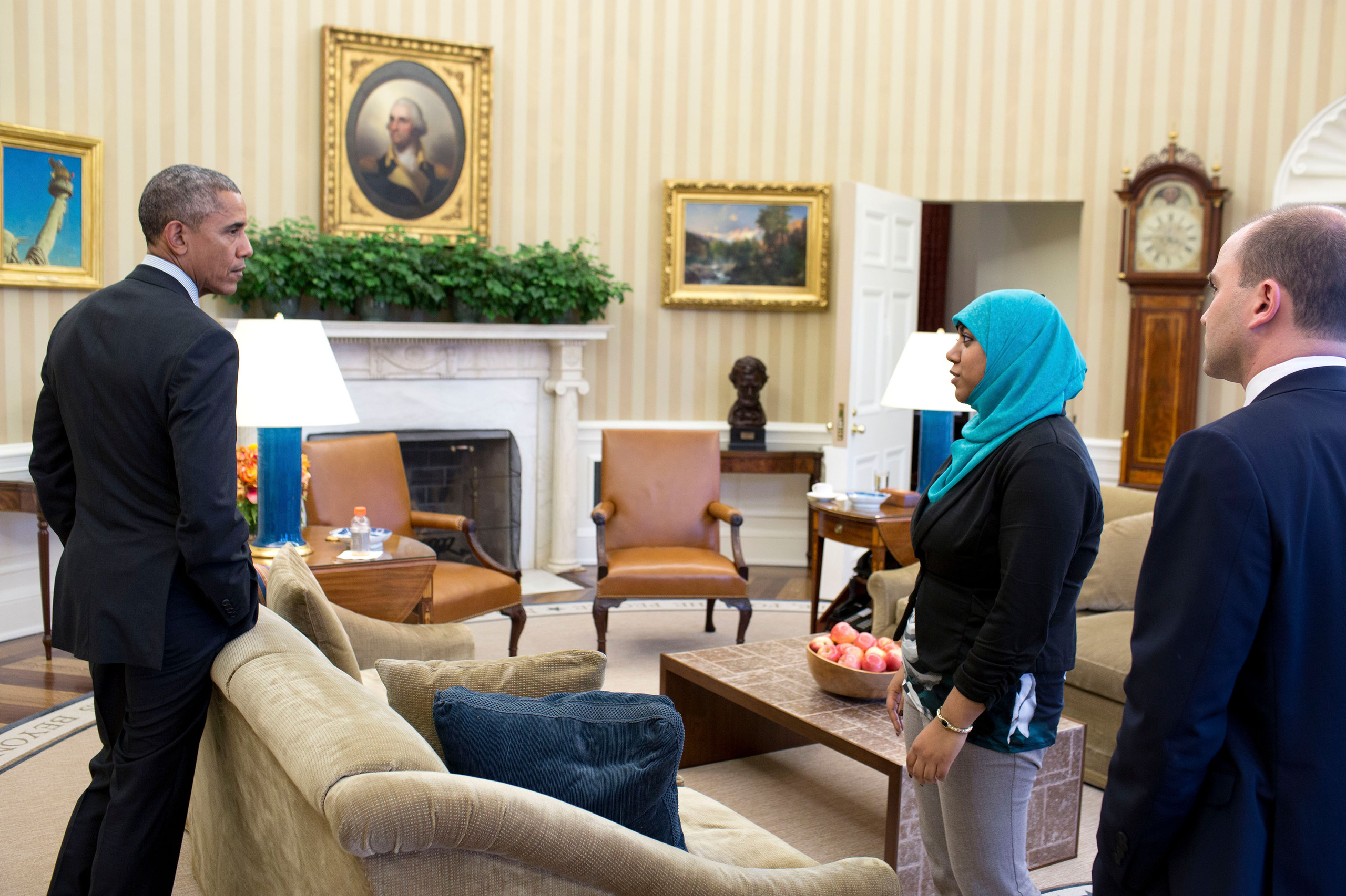 President Barack Obama holds American Muslim leaders meeting prep in the Oval Office, Feb. 4, 2015. Participants are:  Ben Rhodes, Deputy National Security Advisor for Strategic Communications and Rumana Ahmed, Advisor to the Deputy National Security Advisor, NSC. (Official White House Photo by Pete Souza)  This photograph is provided by THE WHITE HOUSE as a courtesy and may be printed by the subject(s) in the photograph for personal use only. The photograph may not be manipulated in any way and may not otherwise be reproduced, disseminated or broadcast, without the written permission of the White House Photo Office. This photograph may not be used in any commercial or political materials, advertisements, emails, products, promotions that in any way suggests approval or endorsement of the President, the First Family, or the White House. Consistent with these restrictions, a commercial printer may produce print(s) of the photograph for the subject(s) personal use.